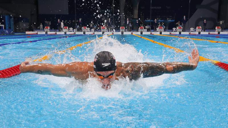Caeleb Dressel races the final of the men's 100m butterfly on Day 8 at the Tokyo Olympics.