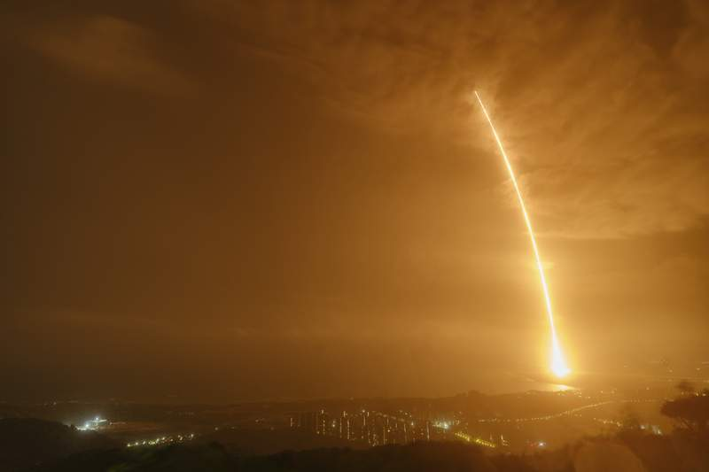 In this photo released by China's Xinhua News Agency, a Long March 7 rocket carrying the Tianzhou-2 spacecraft lifts off from the Wenchang Space Launch Center in Wenchang in southern China's Hainan Province, Saturday, May 29, 2021. A rocket carrying supplies for China's new space station blasted off Saturday from an island in the South China Sea. (Guo Wenbin/Xinhua via AP)