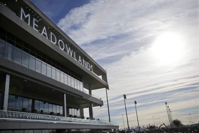FILE - This Nov. 20, 2013 file photo shows the Meadowlands race track in East Rutherford, N.J. Two years after filing a first-of-its-kind lawsuit, an aggrieved harness-racing bettor has received $20,000 in the settlement of his claims that he was cheated out of his winnings when a doped horse won a race in New Jersey in 2016. The settlement was reached in July 2020. (AP Photo/Mel Evans, File)