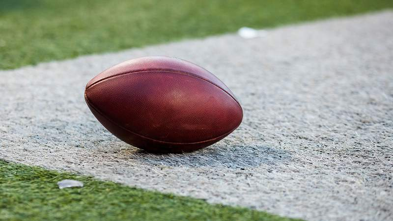A football on the sideline of a football field. (Photo by Brett Carlsen/Getty Images)