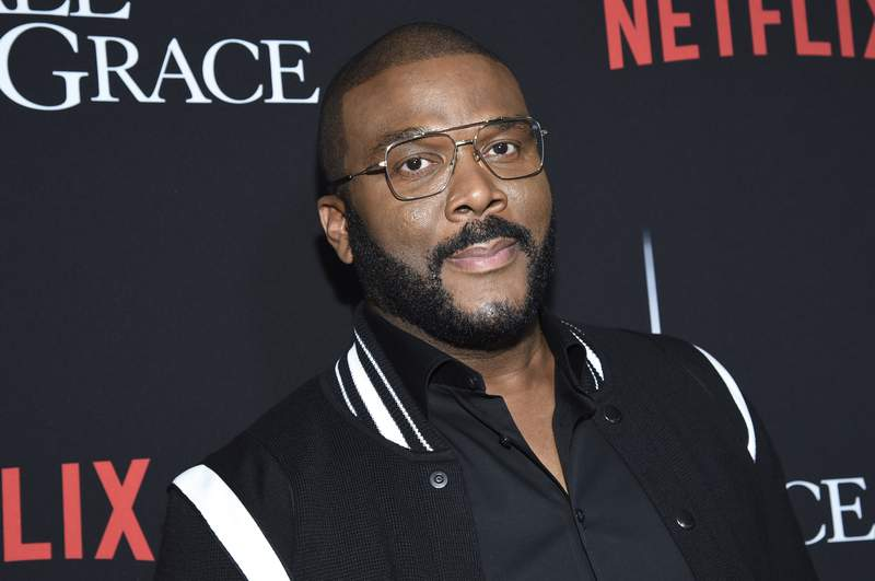 """FILE - In this Jan. 13, 2020, file photo, writer-director-actor Tyler Perry attends the premiere of """"A Fall from Grace"""" at Metrograph in New York. Perry wrote we must never give up in a heartfelt first-person essay in People magazine detailing his thoughts on racial injustice and police brutality against unarmed black people in America. Perry said he almost passed on publishing his essay in the upcoming issue, which will be released Friday, but the filmmaker felt compelled to follow through because hes exhausted from what he's recently seen across the country. (Photo by Evan Agostini/Invision/AP, File)"""