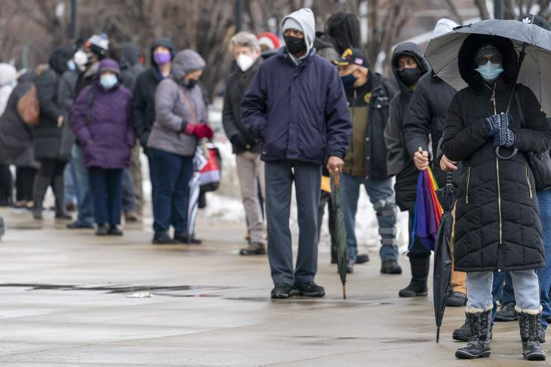 People line up at a COVID-19 vaccination site at Yankee Stadium, Friday, Feb. 5, 2021, in the Bronx borough of New York. (AP Photo/Mary Altaffer)