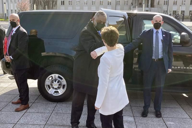 U.S. Defense Secretary Lloyd Austin is greeted by German Defense Minister Annegret Kano-Karrenbauer, Tuesday, April 13, 2021, in Berlin. (AP Photos/Robert Burns)