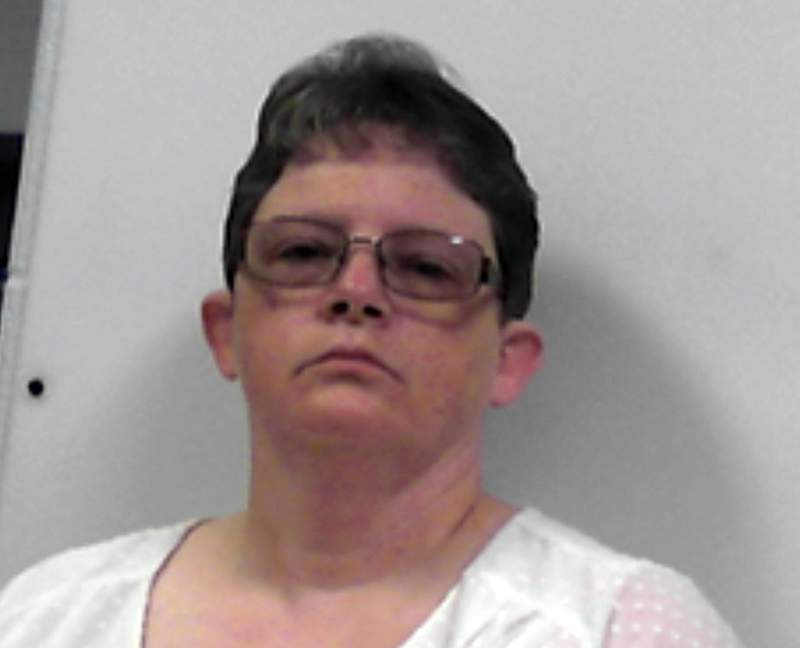 FILE - This photo released July 14, 2020, by the West Virginia Regional Jail and Correctional Facility Authority shows Reta Mays, a former nursing assistant at the Louis A. Johnson VA Medical Center in Clarksburg, W.Va. Tentative settlements have been reached in several civil lawsuits filed on behalf of the families of veterans who died at a West Virginia hospital where Mays, a former nursing assistant admitted to intentionally killing seven people with fatal doses of insulin. The settlements were disclosed by U.S. Sen. Joe Manchin of West Virginia on Saturday. Oct. 10, 2020. (West Virginia Regional Jail and Correctional Facility Authority via AP)