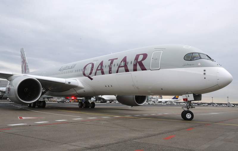 FILE - In this Jan. 15, 2015, file photo, a new Qatar Airways Airbus A350 approaches the gate at the airport in Frankfurt, Germany.   American Airlines and Qatar Airways said Tuesday, Feb. 25, 2020,  they will put aside past hostilities and revive a partnership selling seats on some of each others flights and splitting the revenue. American says it hopes that the arrangement will boost its ability to sell travel to India and elsewhere in Asia and also to Africa  weak spots in its current network. (AP Photo/Michael Probst, File)