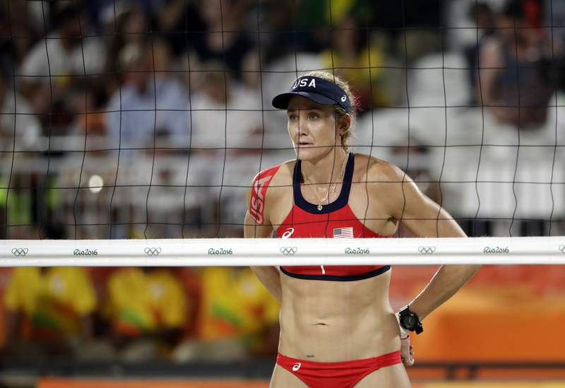 FILE - In this Aug. 15, 2016, file photo, United States' Kerri Walsh Jennings awaits a serve against Australia during a women's beach volleyball quarterfinal match at the 2016 Summer Olympics in Rio de Janeiro, Brazil. The three-time beach volleyball gold medalist was defeated in her bid to reach a sixth Olympics when she and partner Brooke Sweat lost in a qualifying match on Wednesday, June 2, 2021 in Ostrava, Czech Republic (AP Photo/Marcio Jose Sanchez, File)