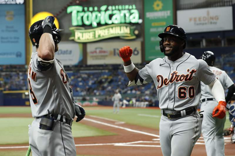 Detroit Tigers' Akil Baddoo, right, celebrates his home run with teammate Detroit Tigers' Robbie Grossman during the first inning of a baseball game against the Tampa Bay Rays Friday, Sept. 17, 2021, in St. Petersburg, Fla.