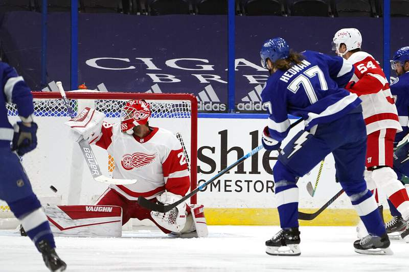 Tampa Bay Lightning defenseman Victor Hedman (77) watches his goal get past Detroit Red Wings goaltender Thomas Greiss (29) during the first period of an NHL hockey game Wednesday, Feb. 3, 2021, in Tampa, Fla. (AP Photo/Chris O'Meara)