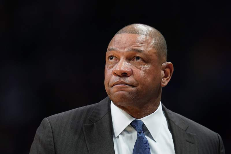 FILE - In this Jan. 12, 2020, file photo, Los Angeles Clippers coach Doc Rivers watches during the second quarter of the team's NBA basketball game against the Denver Nuggets in Denver. The Philadelphia 76ers have reached an agreement with Rivers to become their new coach. Rivers reached a deal Thursday to become the latest coach to try to lead the Sixers to their first NBA championship since 1983, a person with direct knowledge of the negotiations told The Associated Press. The person spoke to the AP on Thursday on condition of anonymity because the Sixers had not formally announced the move. (AP Photo/Jack Dempsey, File)