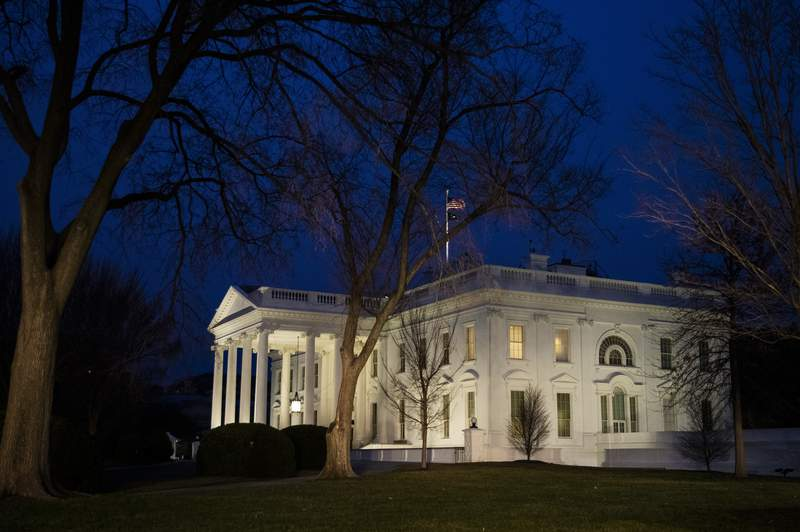 FILE - In this Feb. 5, 2020 file photo, The White House is seen in Washington. President Donald Trump and first lady Melania Trump will host the administration's third state dinner in April for King Felipe VI and Queen Letizia of Spain, the White House announced Tuesday. (AP Photo/Manuel Balce Ceneta)