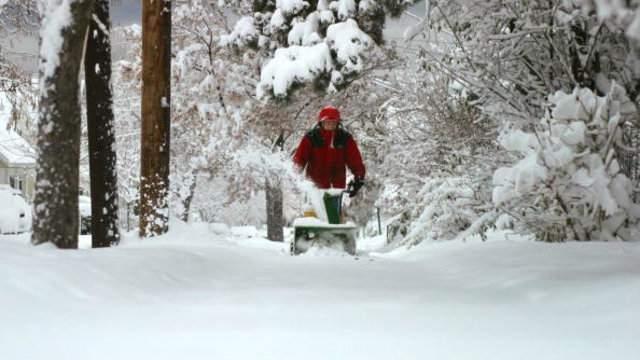 Man snow blowing (Photo by Jordan Silverman/Getty Images)
