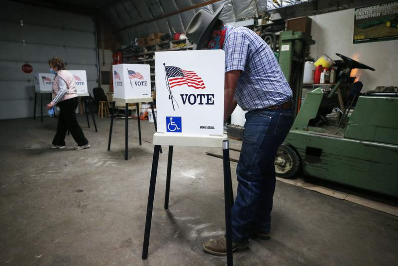 A voter marks his ballot at a polling place in Dennis Wilkening's shed on Nov. 3 in Richland, Iowa.