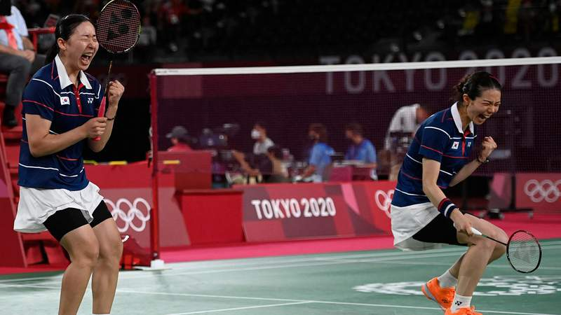 South Korea's Kong Hee-yong and Kim So-yeong celebrate after winning their women's doubles badminton quarterfinal match against Japan.