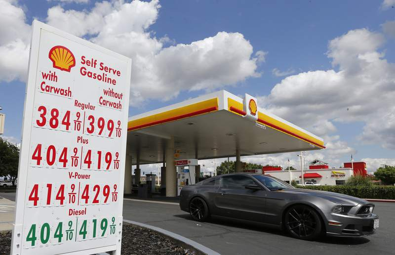 FILE - In this May 17, 2019, file photo, a car leaves a Shell station after getting gas in Sacramento, USA. Royal Dutch Shell increased its dividend payout to shareholders following a better-than-expected third quarter of the year, months after cutting it for the first time since World War II. The oil giant, which is trying to transform itself into a carbon-neutral energy company, said Thursday, Oct. 29, 2020 that it was planning to increase its dividend by 4% to 16.65 U.S. cents per share for the third quarter. (AP Photo/Rich Pedroncelli, File)
