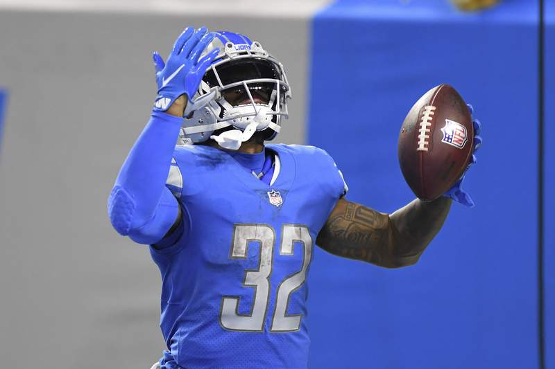 Detroit Lions running back D'Andre Swift (32) celebrates his 43-yard touchdown reception against the San Francisco 49ers in the second half of an NFL football game in Detroit, Sunday, Sept. 12, 2021. (AP Photo/Lon Horwedel)