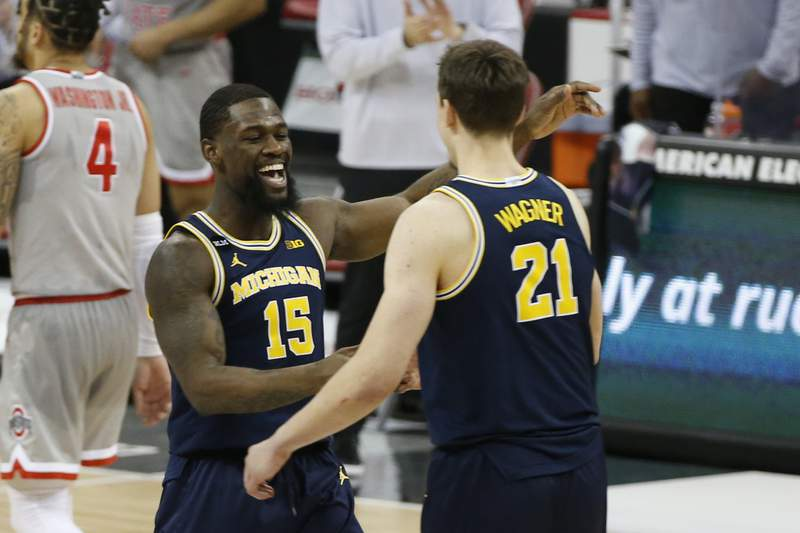 Michigan's Chaundee Brown, left, and Franz Wagner celebrates their win over Ohio State after an NCAA college basketball game Sunday, Feb. 21, 2021, in Columbus, Ohio.  (AP Photo/Jay LaPrete)