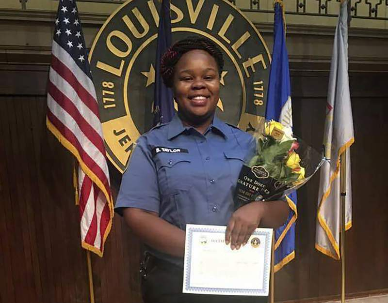 FILE - This undated file photo provided by Taylor family attorney Sam Aguiar shows Breonna Taylor in Louisville, Ky.  In news reported on Tuesday, Dec. 29, 2020, Louisville police have taken steps that could result in the firing of an officer who sought the no-knock search warrant that led detectives to the apartment where Taylor was fatally shot. (Courtesy of Taylor Family attorney Sam Aguiar via AP, File)