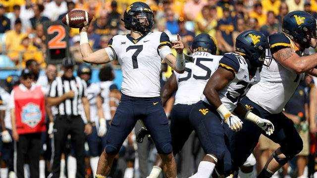 Will Grier #7 of the West Virginia Mountaineers drops back to pass against the Tennessee Volunteers during their game at Bank of America Stadium on September 1, 2018 in Charlotte, North Carolina. (Photo by Streeter Lecka/Getty Images)