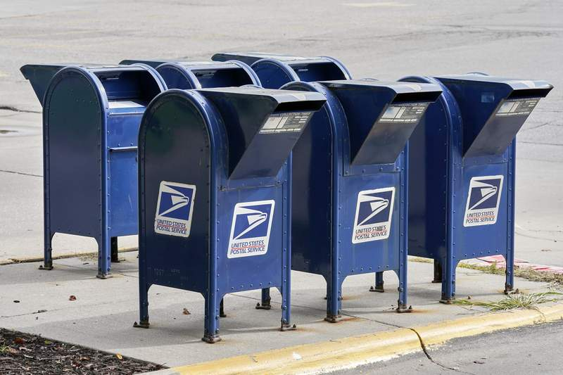 """Mailboxes in Omaha, Neb., Tuesday, Aug. 18, 2020. The Postmaster general announced Tuesday he is halting some operational changes to mail delivery that critics warned were causing widespread delays and could disrupt voting in the November election. Postmaster General Louis DeJoy said he would """"suspend"""" his initiatives until after the election """"to avoid even the appearance of impact on election mail."""" (AP Photo/Nati Harnik)"""