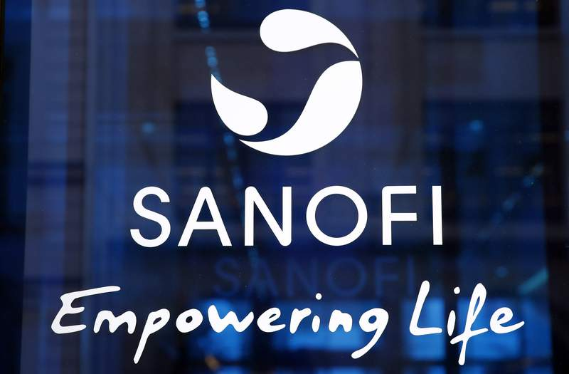 FILE - In this Feb. 7, 2019 the logo of French drug maker Sanofi is pictured at the company's headquarters, in Paris. Sanofi is going to produce as many as 12 million coronavirus vaccine doses per month for rival Johnson & Johnson, the second time the French drug maker is turning over production facilities to speed up supplies of a rival company's vaccine, while its own candidate faces delays. (AP Photo/Christophe Ena, File)