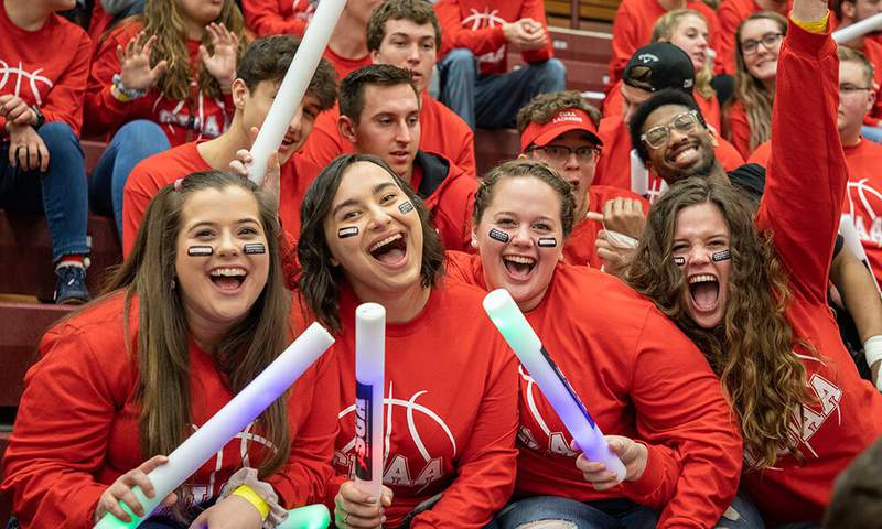 CUAA students cheer at an athletic event.