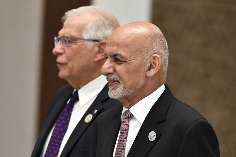 Representative of the EU for Foreign Affairs and Security Policy, Josep Borrell, left, Afghanistan's President Ashraf Ghani, walks to attend the Central and South Asia 2021 conference in Tashkent, Uzbekistan, Friday, July 16, 2021. (AP Photo)