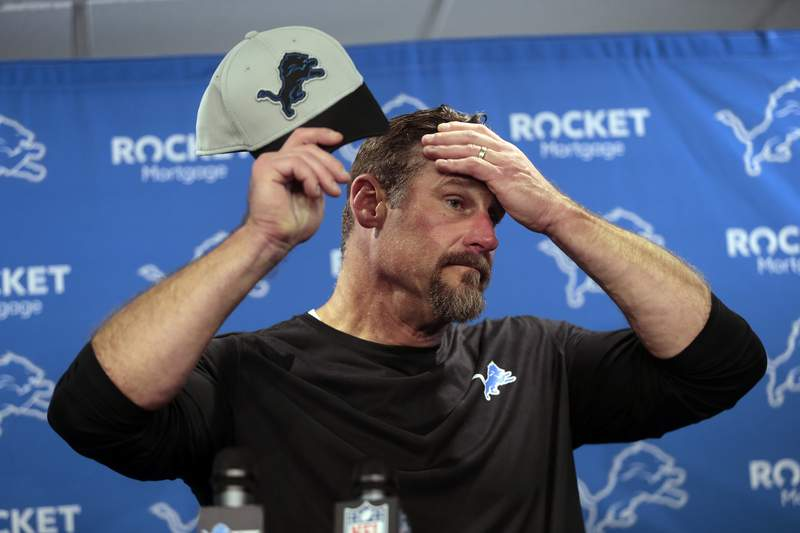 Detroit Lions head coach Dan Campbell adjusts his cap as he speaks to the media after an NFL football game against the Baltimore Ravens in Detroit, Sunday, Sept. 26, 2021. (AP Photo/Tony Ding)