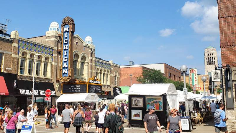 Visitors and artist booths in front of the Michigan Theater during the 2021 Ann Arbor Art Fair