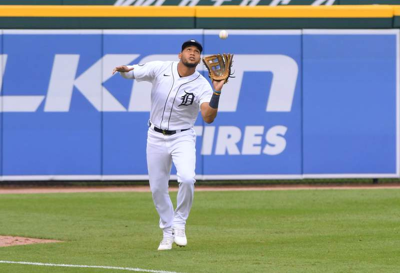 Victor Reyes #22 of the Detroit Tigers catches a baseball during the game against the Cleveland Indians at Comerica Park on August 14, 2020 in Detroit, Michigan. The Indians defeated the Tigers 10-5.