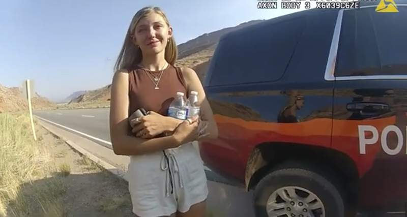 """FILE - This police camera video provided by The Moab Police Department shows Gabrielle """"Gabby"""" Petito talking to a police officer after police pulled over the van she was traveling in with her boyfriend, Brian Laundrie, near the entrance to Arches National Park on Aug. 12, 2021.  Teton County Coroner Brent Blue is scheduled to announce the findings of Petito's autopsy at a news conference early Tuesday, Oct. 12. (The Moab Police Department via AP)"""