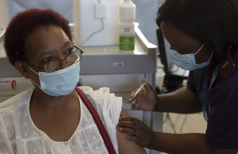 FILE  In this Friday, March 5, 2021 file photo, health care worker Maggie Sedidi receives a Johnson & Johnson COVID-19 vaccine at a vaccination center in Soweto, South Africa. (AP Photo/Themba Hadebe/File)