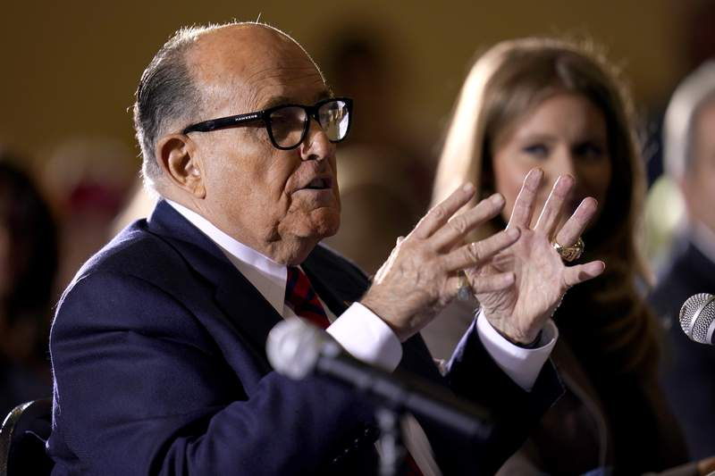 FILE - In this Nov. 25, 2020, file photo former Mayor of New York Rudy Giuliani, a lawyer for President Donald Trump, speaks at a hearing of the Pennsylvania State Senate Majority Policy Committee in Gettysburg, Pa. An appeals court suspended Giuliani from practicing law in New York because he made false statements while trying to get courts to overturn Trumps loss in the presidential race. The ruling, signed Thursday, June 24 will prevent Giuliani from representing clients as a lawyer. (AP Photo/Julio Cortez, File)