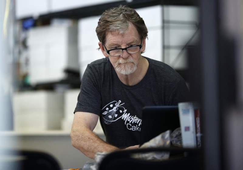 FILE - In this June 4, 2018, file photo, baker Jack Phillips, owner of Masterpiece Cakeshop, manages his shop in Lakewood, Colo. Phillips, the Colorado baker who won a partial victory at the U.S. Supreme Court in 2018 for refusing to make a wedding cake for a same-sex couple, violated the state's anti-discrimination law by refusing to make a birthday cake for a transgender woman, Denver District Judge A. Bruce Jones ruled, Tuesday, June 15, 2021. The group representing Phillips, Alliance Defending Freedom, said Wednesday, June 16, that it would appeal the ruling, which ordered him to pay a $500 fine.  (AP Photo/David Zalubowski, File)