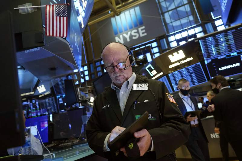 Trader John Doyle works on the floor of the New York Stock Exchange, Friday, July 16, 2021. Stocks are off to a slightly higher start on Wall Street Friday with an assist from several big technology companies. (AP Photo/Richard Drew)