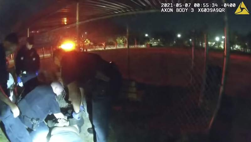 This photo taken from Providence Police body camera shows officers responding to a call Friday, May 7, 2021 of a man who was screaming outside in Providence, R.I.    State authorities are investigating the case of the man who died after being handcuffed by police. Body camera video shows they spent more than ten minutes trying to calm him down before holding him down on his stomach for about 90 seconds while cuffing him behind his back. He then appeared to collapse, and was pronounced dead at a hospital. (Providence Police Department via AP)