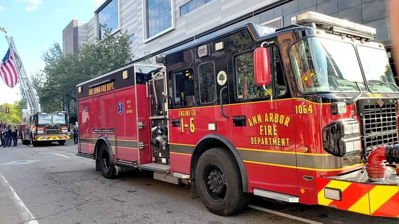 An Ann Arbor Fire Department engine flies a large American flag.