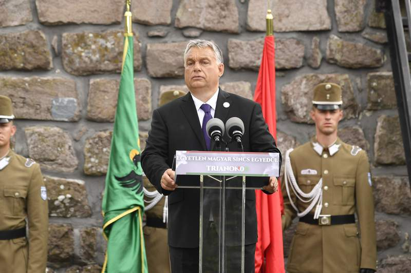 Hungarian Prime Minister Viktor Orban delivers his speech during the inauguration of the Centenary Turul Statue in commemoration of the 100th anniversary of the Trianon Peace Treaty in Satoraljaujhely, Hungary, Saturday, June 6, 2020. The Turul, mostly depicted as a hawk or falcon, is a mythological bird and the ancient symbol of Hungarian national identity and togetherness. Hungary is commemorating the 100th anniversary of a post-World War I peace treaty which led to the loss of about two-thirds of its territory and left some 3.3 million Hungarians outside the country's new borders. (Zoltan Mathe/MTI via AP)