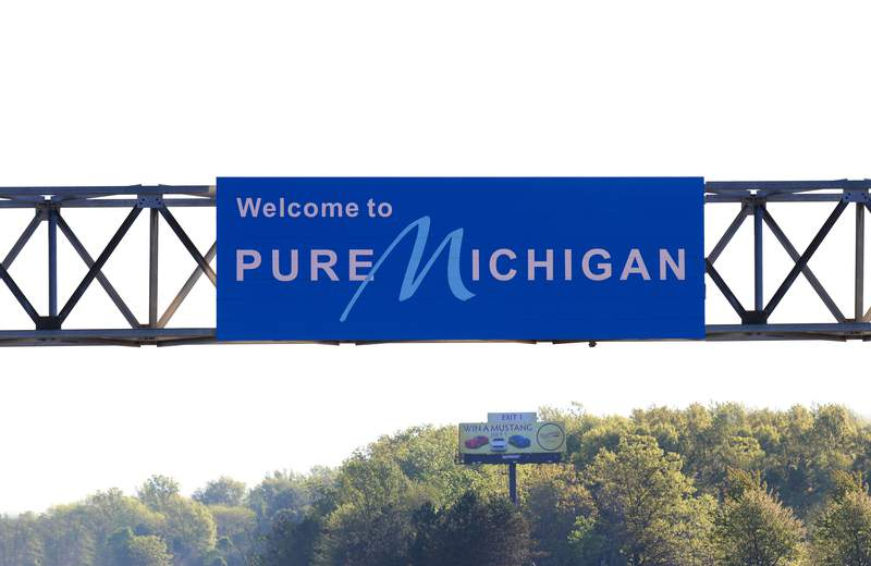 NEW BUFFALO, MI - MAY 24:  'Welcome To Pure Michigan' signage along Interstate 94 in New Buffalo, Michigan on May 24, 2018.  (Photo By Raymond Boyd/Getty Images)