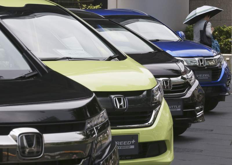 FILE - In this July 31, 2019, file photo, Honda cars are displayed at the automaker's headquarters in Tokyo. The Japanese automaker sank deeper into losses for the fiscal quarter ended in March, 2020, as the damage to the industry set off by the coronavirus outbreak hurt sales and crimped production.  Tokyo-based Honda reported Tuesday, May 12, 2020, a January-March loss of 29.5 billion yen ($276 million).  (AP Photo/Koji Sasahara, File)