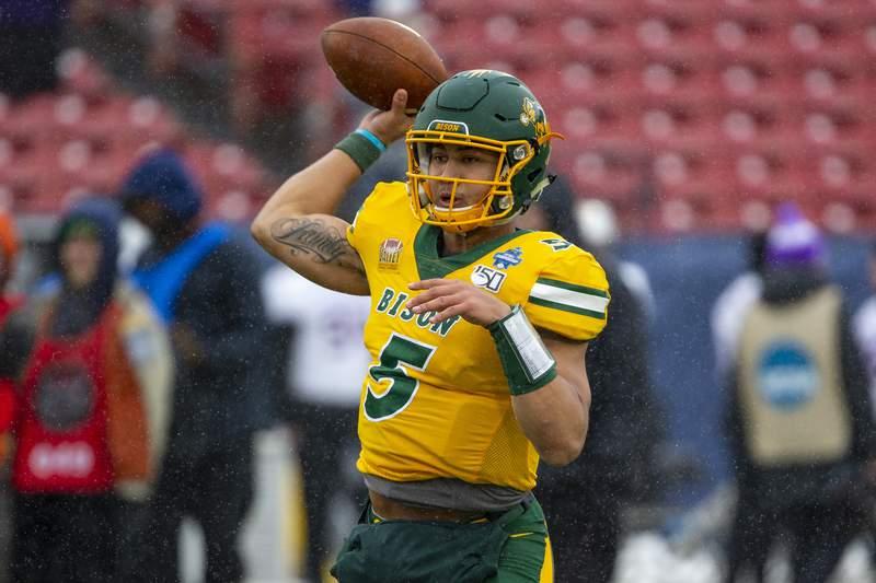 North Dakota State quarterback Trey Lance (5) warms up before the FCS championship NCAA college football game against James Madison, Saturday, Jan. 11, 2020, in Frisco, Texas. (AP Photo/Sam Hodde)