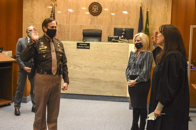 Incumbents County Executive Dave Coulter, Clerk/Register of Deeds Lisa Brown, Sheriff Michael Bouchard and Water Resources Commissioner Jim Nash were each administered their oath of office during the brief ceremony.
