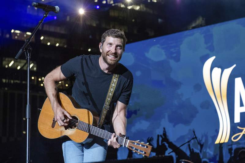 FILE - In this Tuesday, August 24, 2021, file photo, Brett Eldredge performs at the 2021 ACM Party for a Cause at Ascend Amphitheater, in Nashville, Tenn. Country singer Eldredge has had another encounter with wildlife, this one involving a bear at a North Carolina home. This week, Eldredge posted a video of the run-in after the bear entered a garage at a home in Asheville, N.C., as he was about to go on a hike, The Charlotte Observer reported. (Photo by Amy Harris/Invision/AP, File)