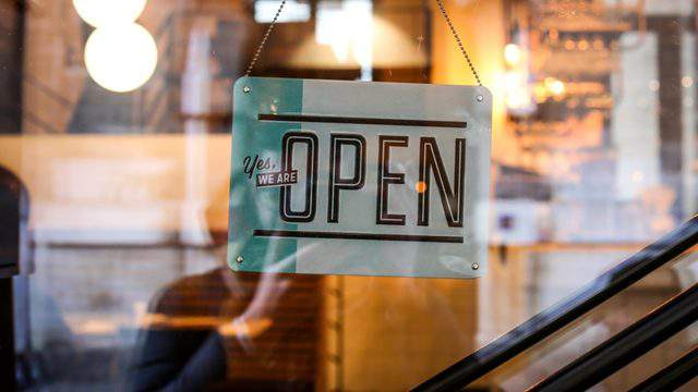 A sign showing that a business is open.