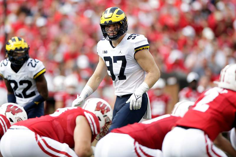 Aidan Hutchinson #97 of the Michigan Wolverines prior to the snap against the Wisconsin Badgers at Camp Randall Stadium on October 02, 2021 in Madison, Wisconsin. Michigan defeated Wisconsin 38-17.