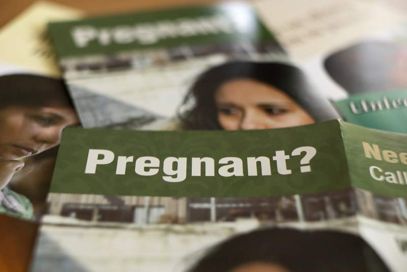 Pregnancy and abortion related brochures in Austin on June 4, 2021.