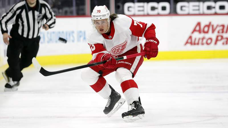 Detroit Red Wings' Troy Stecher (70) clears the puck against the Carolina Hurricanes during the third period of an NHL hockey game in Raleigh, N.C., Monday, April 12, 2021. (AP Photo/Karl B DeBlaker)