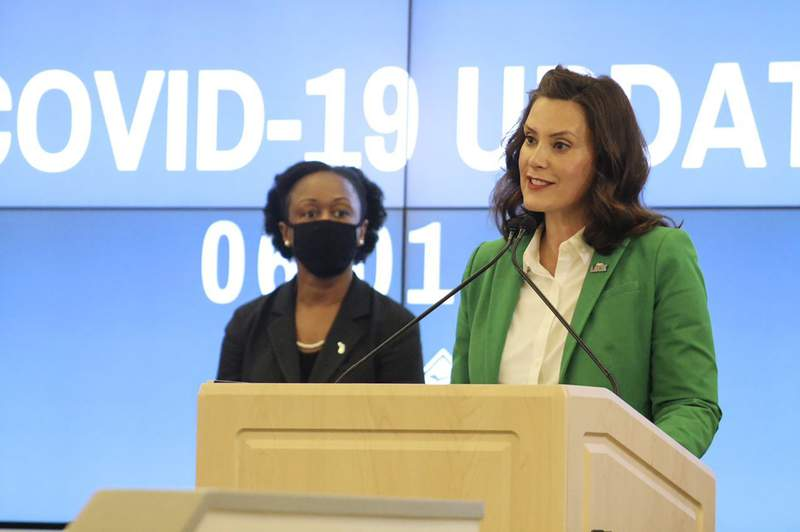 In this Monday, June 1, 2020, photo provided by the Michigan Office of the Governor, Michigan Gov. Gretchen Whitmer speaks during a news conference in Lansing, Mich. Whitmer lifted Michigan's nearly 10-week coronavirus stay-at-home order Monday, letting restaurants reopen to dine-in customers next week and immediately easing limits on outdoor gatherings while keeping social-distancing rules intact. (Michigan Office of the Governor via AP, Pool)