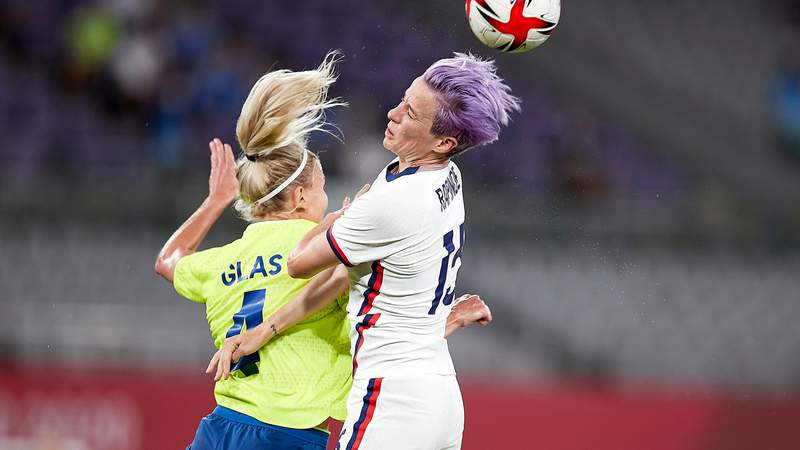 Megan Rapinoe of Team USA and Hanna Glas of Sweden battle for the ball in group play at the Tokyo 2020 Olympic Games at Tokyo Stadium on July 21, 2021 in Chofu, Tokyo, Japan. (Photo by Berengui/DeFodi Images via Getty Images)