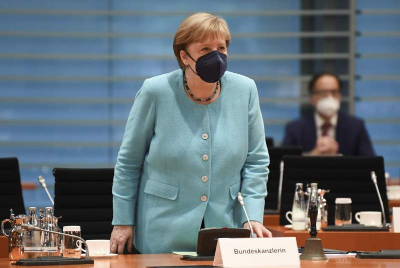 German Chancellor Angela Merkel attends the weekly cabinet meeting at the Chancellery in Berlin, Germany, July 14, 2021. (Annegret Hilse/Pool via AP)