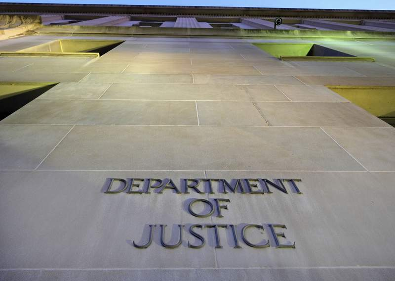 FILE - In this May 14, 2013, file photo, the Department of Justice headquarters building in Washington is photographed early in the morning. CNN says the Trump administration Justice Department secretly obtained the 2017 phone records of CNN correspondent Barbara Starr. (AP Photo/J. David Ake, File)